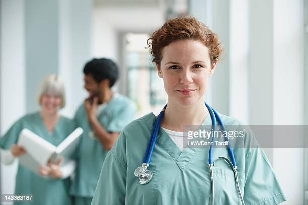Caucasian surgeon standing in hospital