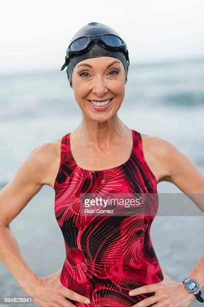 Caucasian swimmer smiling on beach