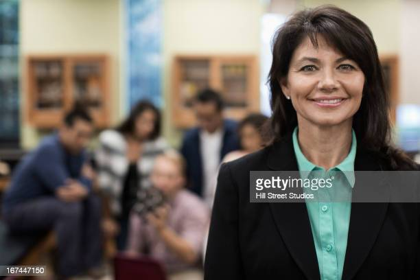 Caucasian teacher smiling in lab classroom