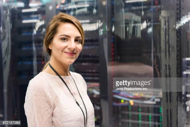 Caucasian technician posing in computer server room