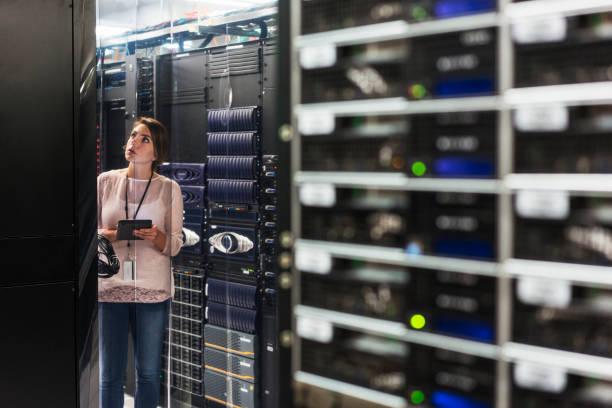 caucasian technician using digital tablet in computer server room picture