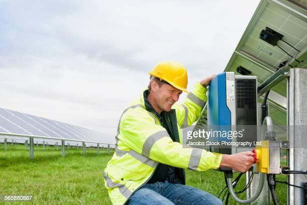 Caucasian technician using industrial control panel