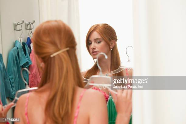 caucasian teenage girl in dressing room - girl in mirror stock-fotos und bilder