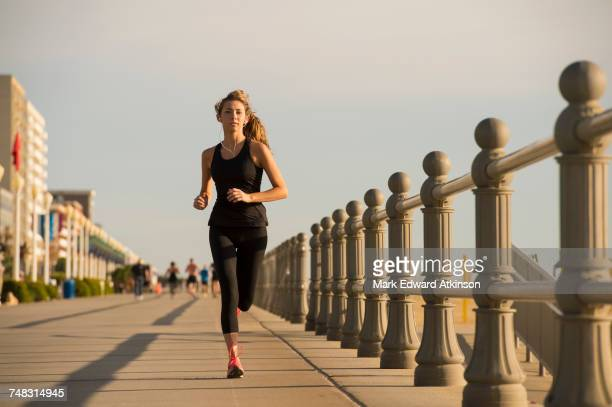 caucasian teenage girl running on boardwalk - extra long stock pictures, royalty-free photos & images