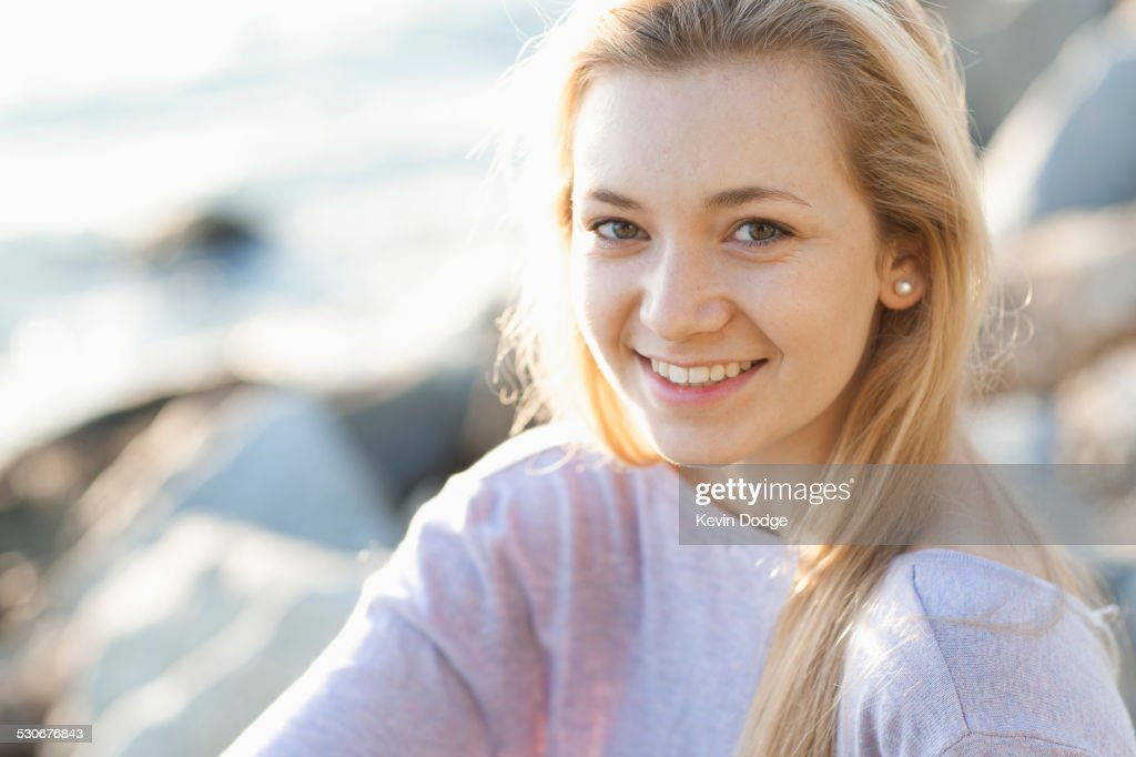 Caucasian teenage girl smiling outdoors : Stock Photo
