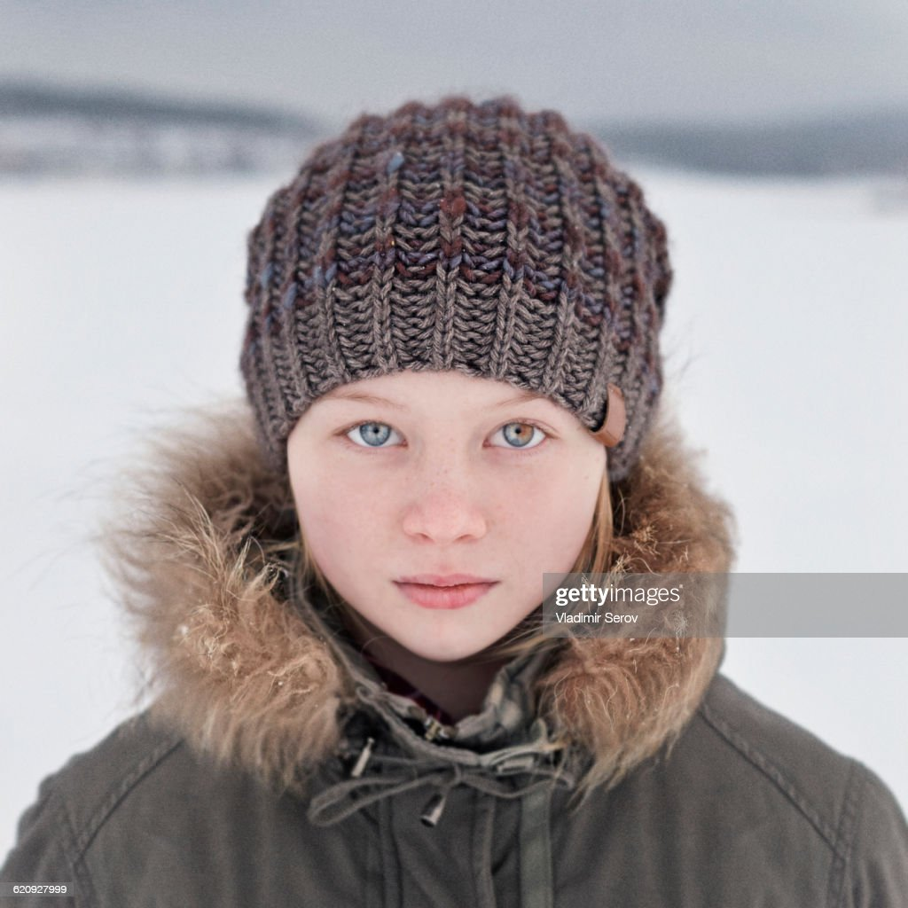 Caucasian Teenage Girl Wearing Beanie Hat In Snow Stock ...
