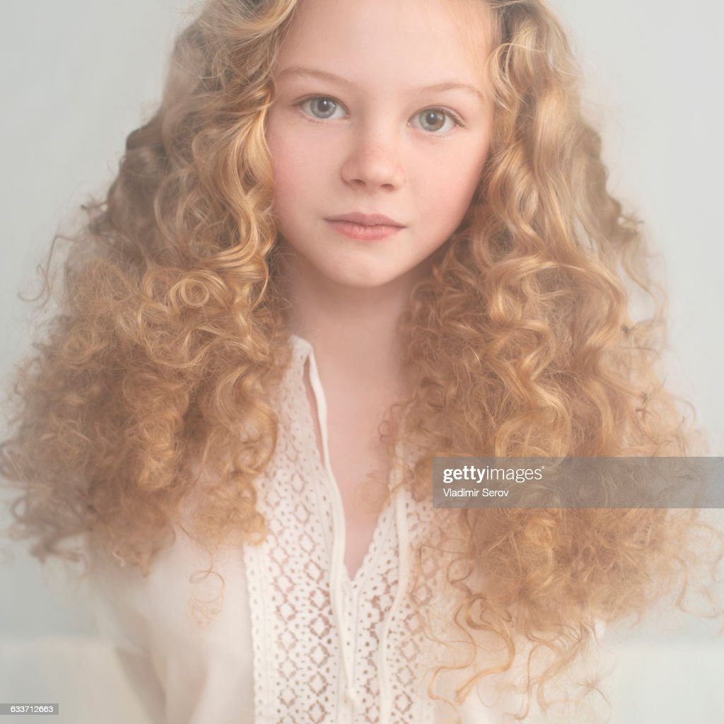 Caucasian teenage girl with curly hair : Stock Photo