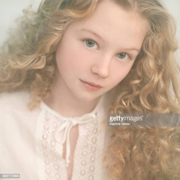 caucasian teenage girl with curly hair - petite teen girl stock photos and pictures