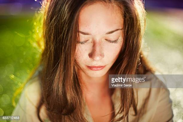 Caucasian teenage girl with eyes closed