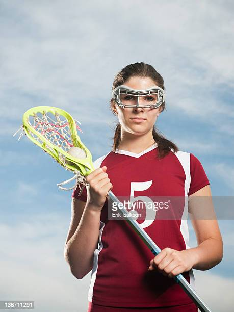 Caucasian teenage lacrosse player