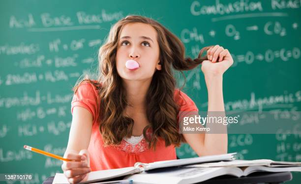 Caucasian teenager daydreaming in classroom
