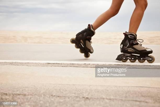 Caucasian teenager roller blading