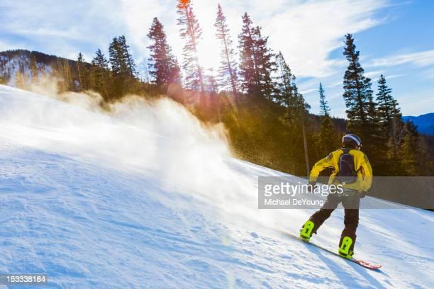 Caucasian teenager snowboarding