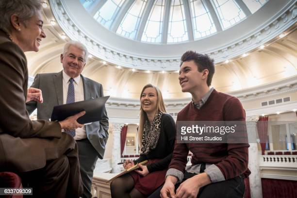 caucasian teenagers talking to politicians in capitol building - talking politics stock pictures, royalty-free photos & images