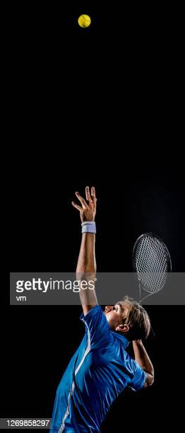 caucasian tennis player making a serve - tennis player stock pictures, royalty-free photos & images