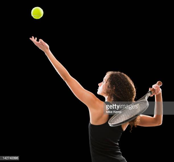 Caucasian tennis player serving the ball