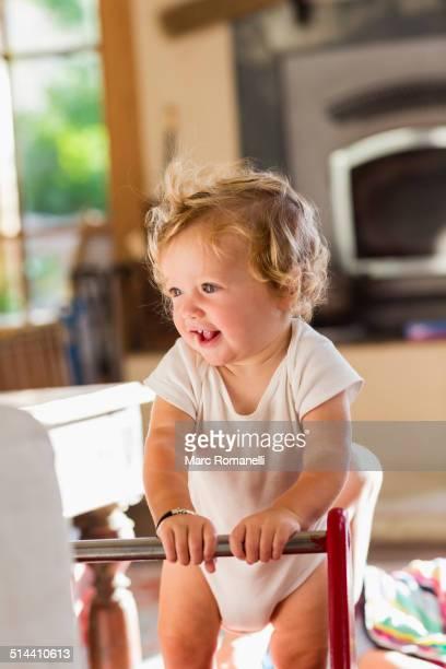 Caucasian toddler standing in living room
