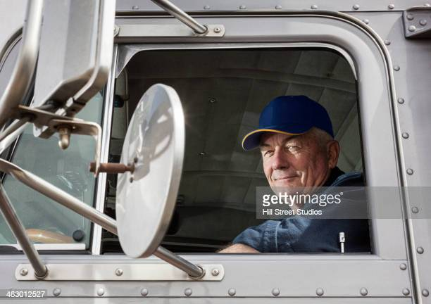 caucasian trucker sitting in semi-truck - one senior man only stock pictures, royalty-free photos & images