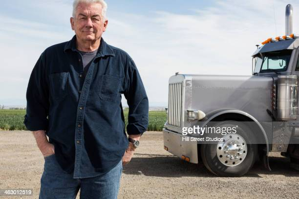 caucasian trucker standing by truck - old truck stock pictures, royalty-free photos & images