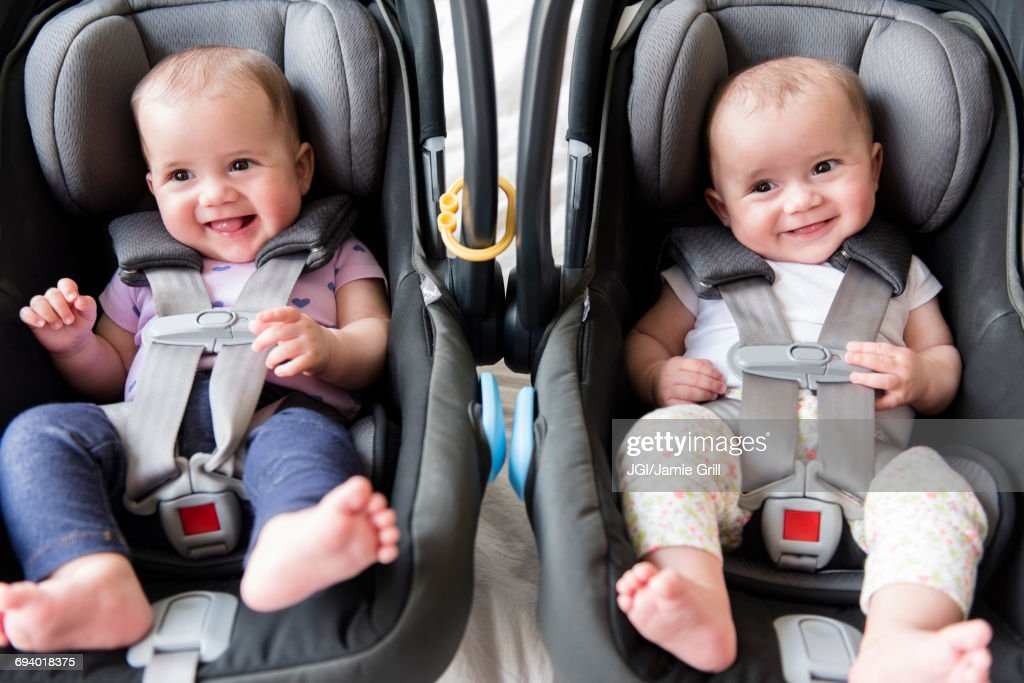 Caucasian twin baby girls in car seats : Stock Photo