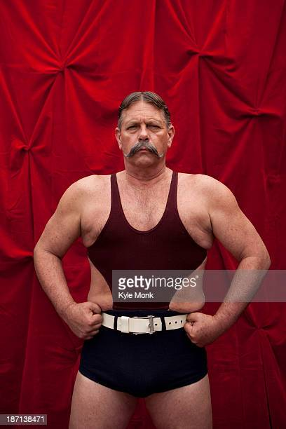 caucasian weight lifter flexing his muscles - circus stock pictures, royalty-free photos & images