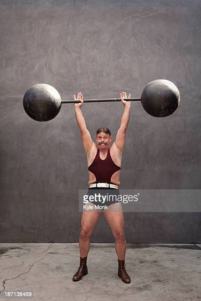 Caucasian weight lifter straining
