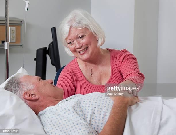 Caucasian wife comforting husband in hospital