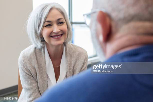 caucasian wife smiles at caucasian husband - vulnerability stock pictures, royalty-free photos & images