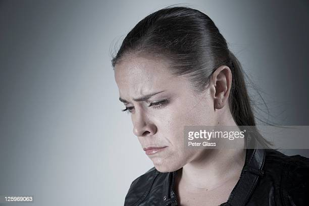 Caucasian woman, 31 years old, with a troubled expression