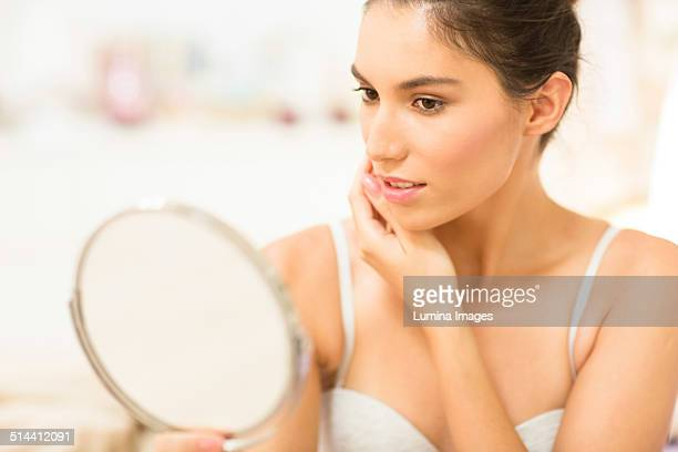 caucasian woman admiring herself in mirror - 鏡 ストックフォトと画像