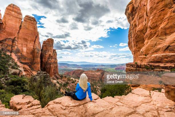 caucasian woman admiring scenic view in desert landscape - sedona stock photos and pictures