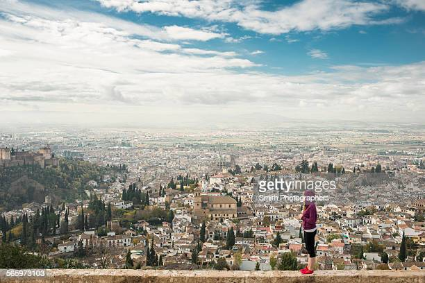 caucasian woman admiring scenic view of cityscape, granada, spain - granada spain stock pictures, royalty-free photos & images