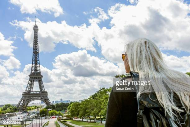 Caucasian woman admiring scenic view of Eiffel Tower