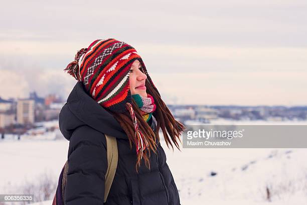 Caucasian woman admiring snowy landscape