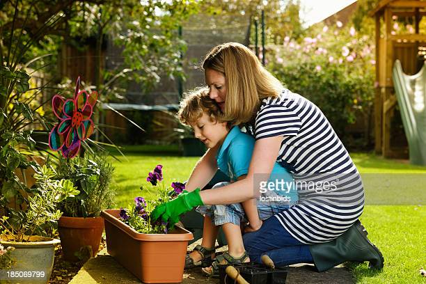 Caucasian Woman And Little Boy Gardening Together