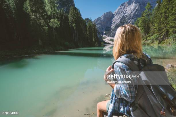 caucasian woman at lake braies, italy - pragser wildsee stock pictures, royalty-free photos & images
