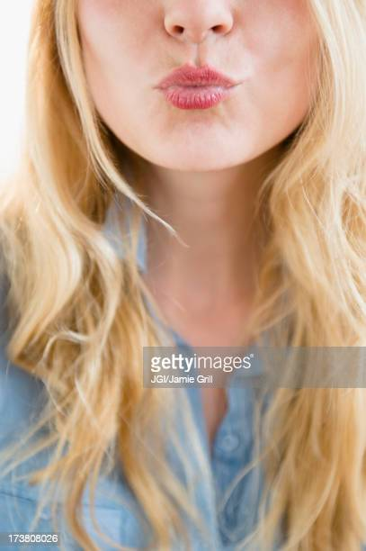 Caucasian woman blowing a kiss