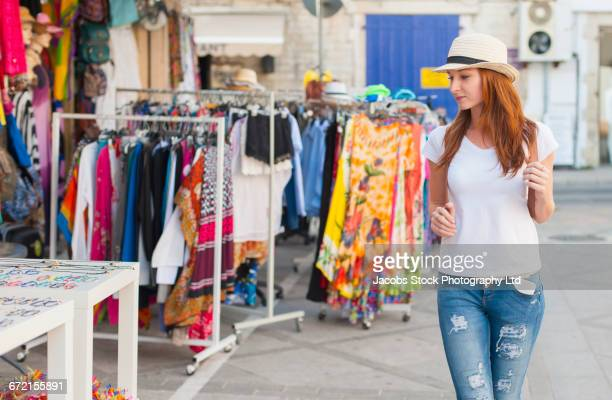 Caucasian woman browsing at sidewalk market