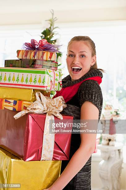 Caucasian woman carrying Christmas gifts