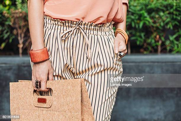 caucasian woman carrying purse outdoors - beige purse stock pictures, royalty-free photos & images