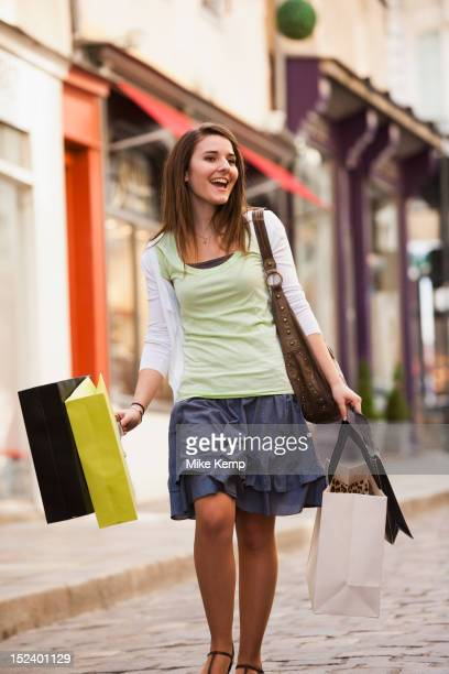Caucasian woman carrying shopping bags