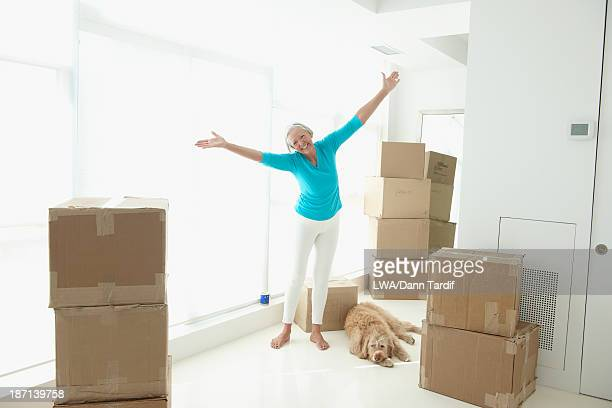 Caucasian woman cheering in new home