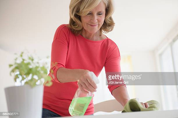 Caucasian woman cleaning table