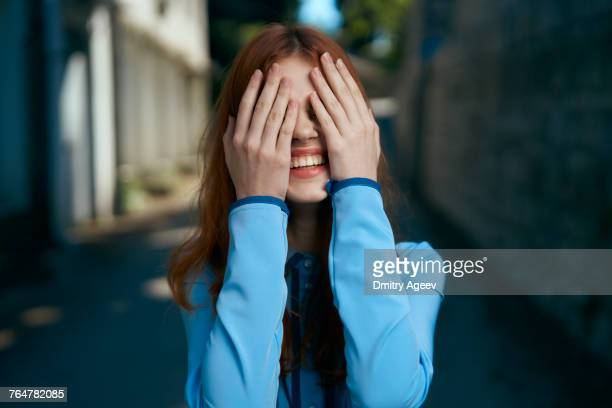 caucasian woman covering eyes with hands - obscured face stock pictures, royalty-free photos & images