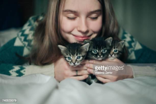 Caucasian woman cuddling kittens