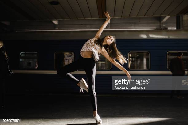 Caucasian woman dancing near train