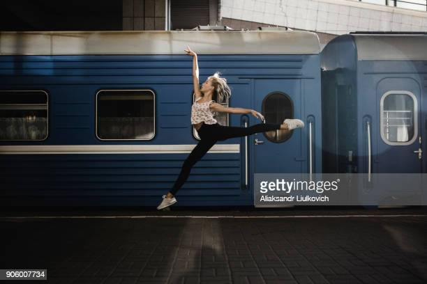 caucasian woman dancing near train - ballet stock pictures, royalty-free photos & images