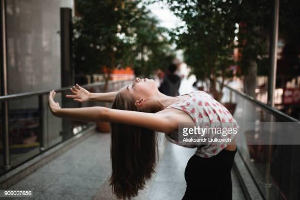 Caucasian woman dancing outdoors