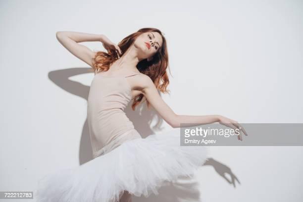caucasian woman dancing wearing tutu - バレエ ストックフォトと画像