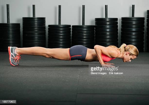 Caucasian woman doing push-ups